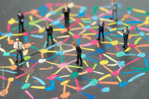 Diversify people or social network concept, miniature people businessmen standin Wallpaper Mural