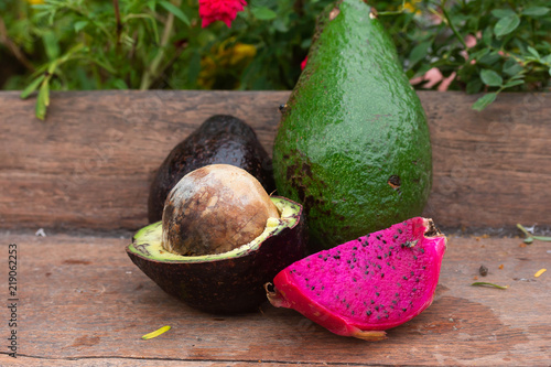 purple dragon fruit and avocado fruit on table background Canvas-taulu