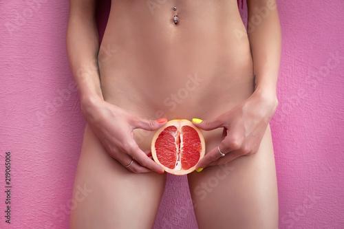 Womens secrets. Girl with grapefruit. Sex concept.