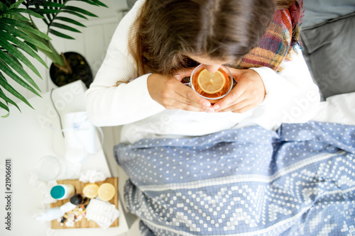 Fotografia  ill young girl with fever spending time at home