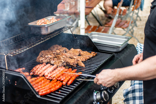 Barbecue grill bbq on propane gas grill steaks bratwurst sausages meat meal
