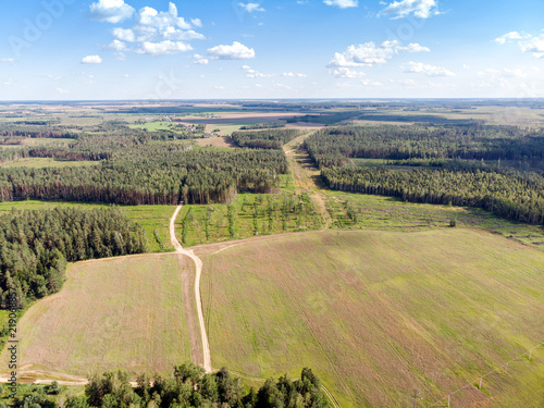 summer landscape scene. green fields, country roads and forests. drone photography