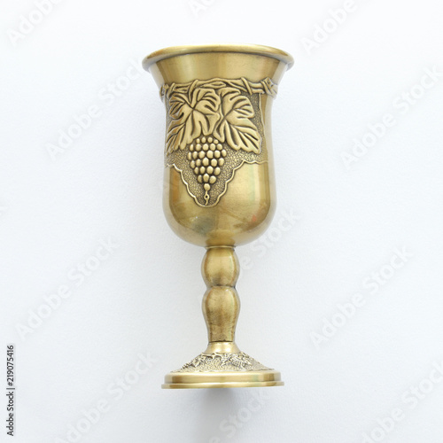 Top view image of jewish wine cup for wine. passover holiday and shabbat concept.