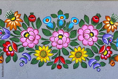 Fotografering  Painted beautiful floral pattern on the facade of an old house, folk art, Zalipie, Poland
