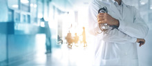 Healthcare And Medical Concept. Medicine Doctor With Stethoscope In Hand And Patients Coming To The Hospital Background.