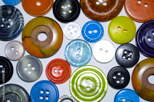 Poster Macarons Multi-colored buttons for sewing. Sewing supplies. Fashion industry. The manufacture of clothing. Accessories for clothes