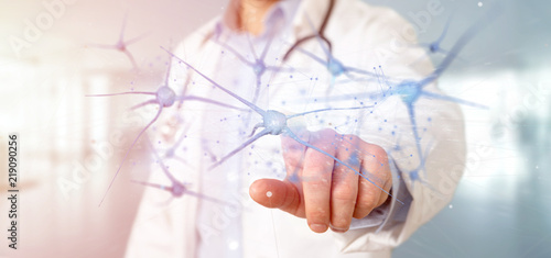 Obraz Doctor holding a 3d rendering group of neurons - fototapety do salonu