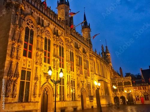 Deurstickers Brugge architecture in bruges belgium at night burg square lit up