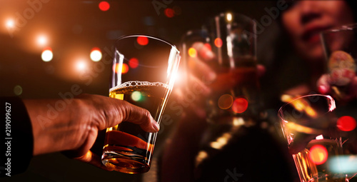 Fotografie, Obraz  Cheers clinking of friends with beer drink in party night after work on colorful blur  background, Group of young people happy having fun together with friendship
