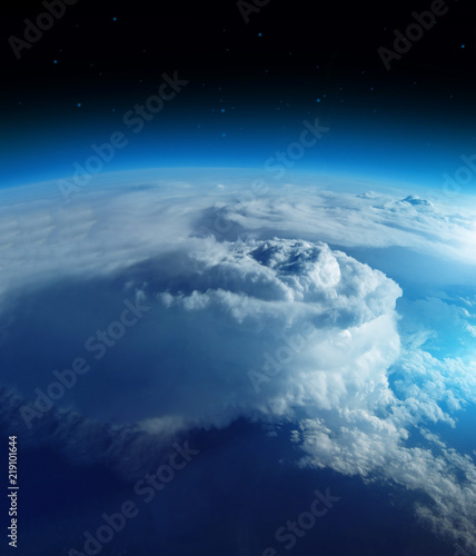 Storm from space on the blue planet earth, 20km above ground / real photo. Elements of this image furnished by NASA