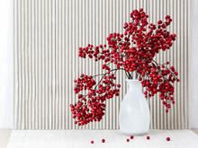 Japanese Vase With Red Berries Of Sacred Bamboo (Nandina Domestica).