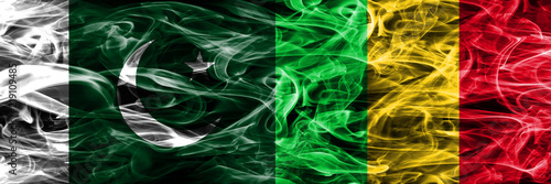 Tuinposter Fractal waves Pakistan vs Mali smoke flags placed side by side. Thick colored silky smoke flags of Pakistan and Mali