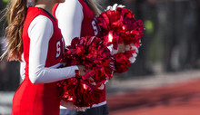 Two Cheerleaders With Red And White Pom Poms