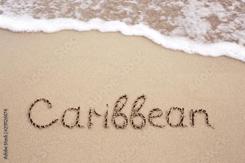 Poster Oceanië Word Caribbean written on the sand near the sea.