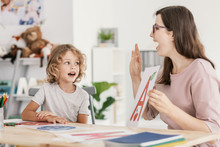 Speech Therapist Teaching Letter A Young Boy In A Classroom