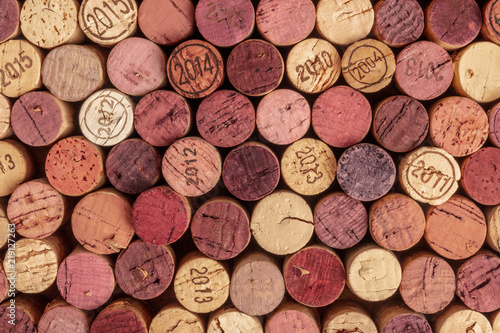 Photo Stands Wine Wine corks background, overhead photo of red and white wine corks