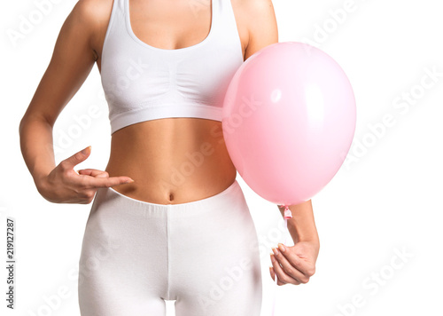 Woman holding a balloon, feeling bloated concept Canvas Print