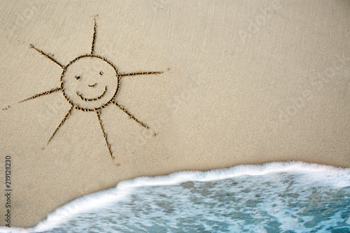 Spoed Foto op Canvas Oceanië Sun drawing in the sand at the caribbean beach.