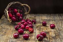 Wicker Basket Of Cherries On W...