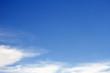 Sky clouds background. Cumulus white clouds in the dark blue sky in the morning