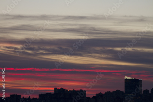 Foto op Canvas Candy roze Sunset over the city. Twilight and high-rise buildings