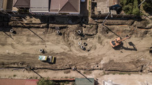 Aerial Construction Site With Machinery. Top Down View Of City Building Site.