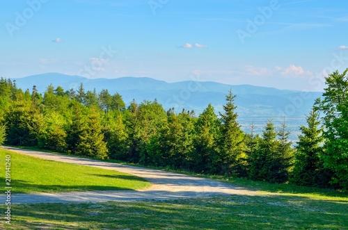 Foto op Aluminium Blauw Spring mountain landscape. A beautiful view of the green hills.