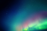Vector illustration with beautiful starry sky and Northern lights. Abstract colorful background with red-green aurora borealis.