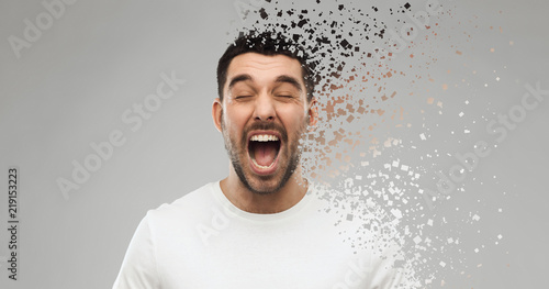 Photo emotions, stress and people concept - crazy shouting man in t-shirt over gray ba