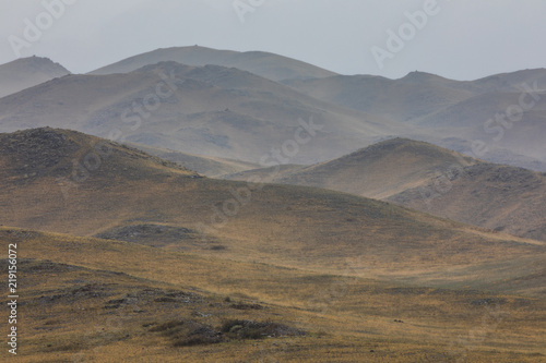 Spoed Foto op Canvas Bleke violet Silhouettes of foggy mountains, Abstract landscape, Haze in the hills, Kazakhstan