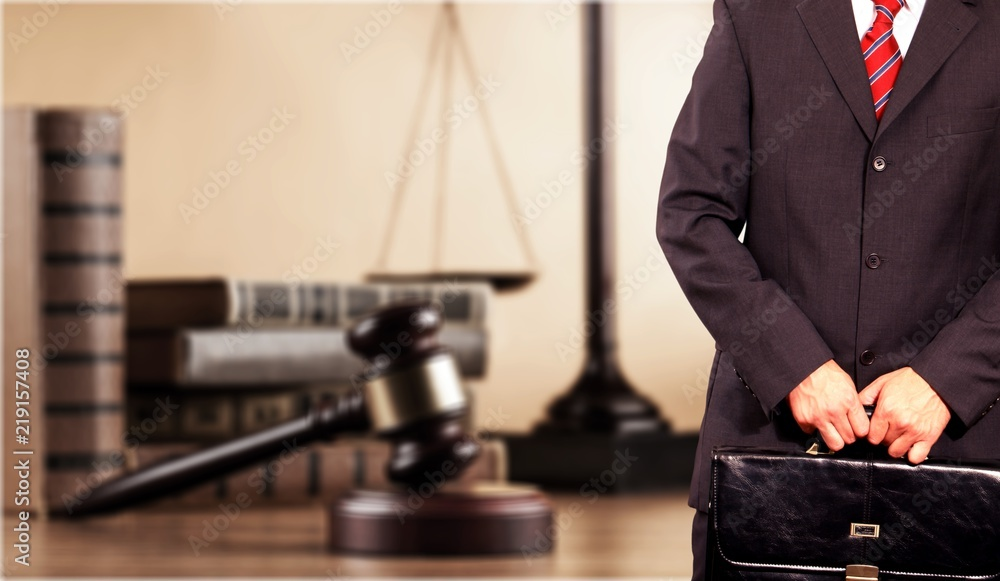 Fototapeta Judge man in black suit holding blue notebook