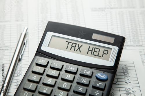 Tax help. On display of calculator is written tax help Fototapet