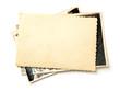 Leinwandbild Motiv Stack old photos isolated on white background. Mock-up blank paper. Postcard rumpled