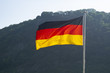 A German flag waving in the wind represents the black, red and yellow national colors of the country.