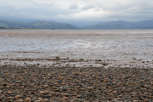 Pebbled Beach Looking Towards Mountains