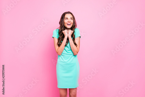 Photographie  Portrait of charmingly cute girl with modern curly hair in turqu