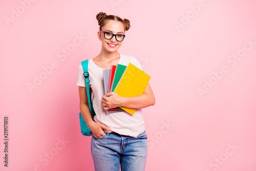 Foto  Portrait of sweet reader schoolgirl in denim jeans holding a mul
