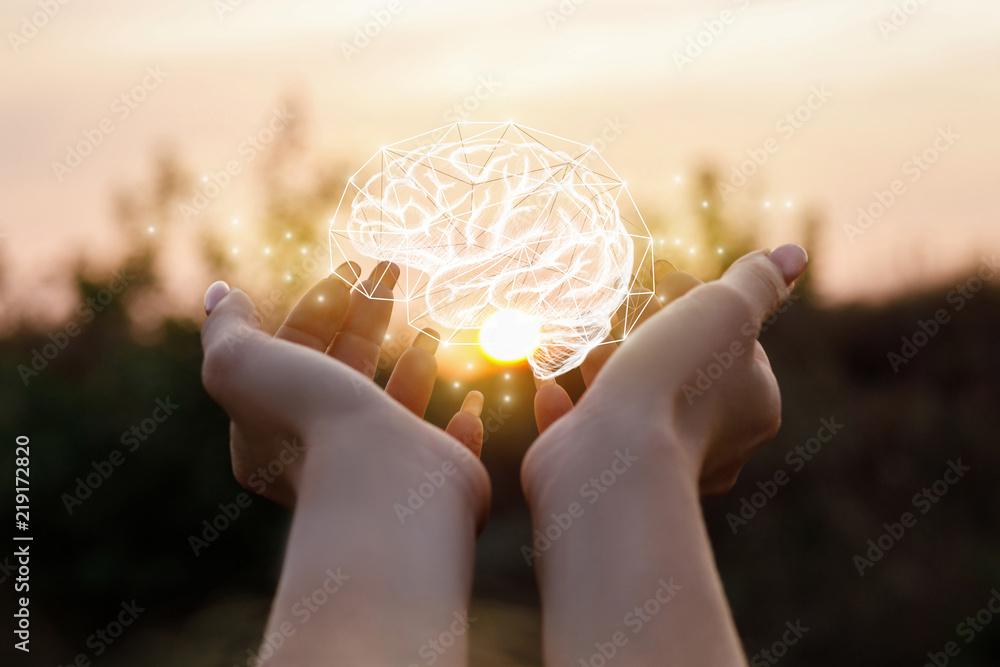 Fototapeta Female hand shows the brain .