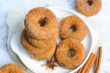 Cinnamon Donuts, Freshly Baked Doughnuts Covered In Sugar And Cinnamon Mixture