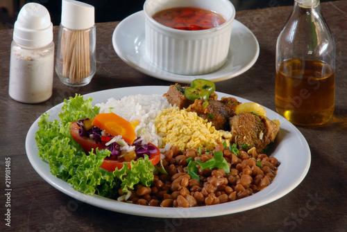 Dish with rice, beans, meat and salad Obraz na płótnie