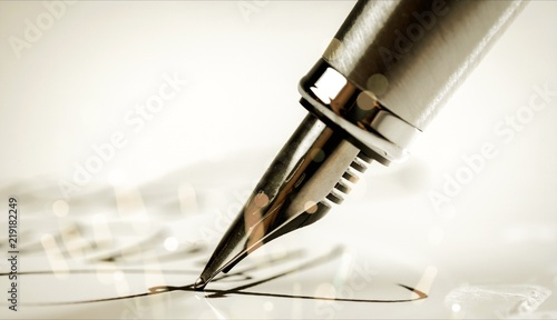 Photo Signing a signature with a fountain pen