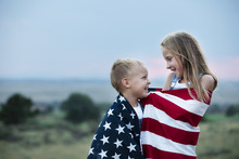 Boy And Girl Holding American ...