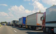 Row Of Trucks On A German Highway