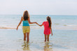 Mom and daughter running on the beach - Family moments, having fun and enjoying summer holiday
