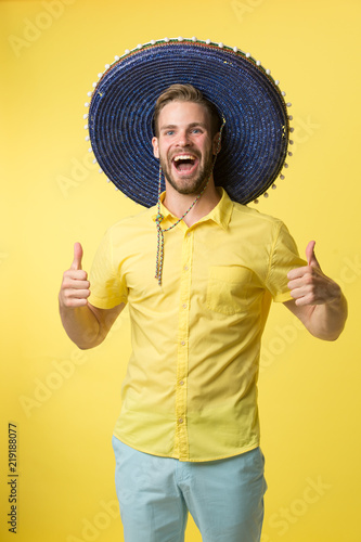 8fd05737ed4 Man cheerful face festive mood posing in sombrero hat yellow background.  Guy with bristle looks