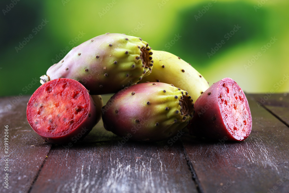 Fototapeta Fruits of the prickly pear cactus on a rustic table.