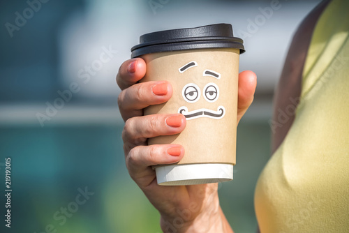 Personified take away coffee cup in woman hand Tablou Canvas