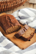 Pumpkin Loaf Cake On Rustic Wo...