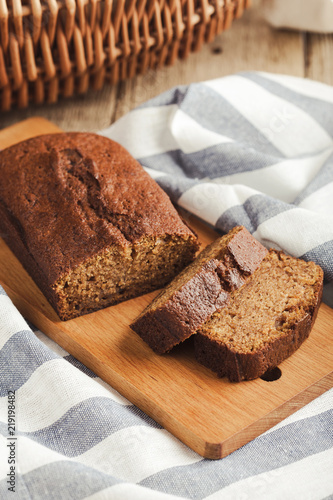 Fotografija Pumpkin loaf cake on rustic wooden board
