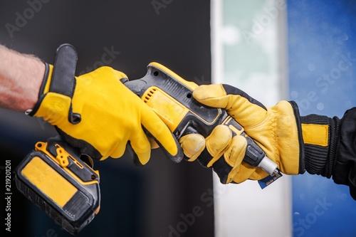 Valokuvatapetti Sharing Construction Equipment